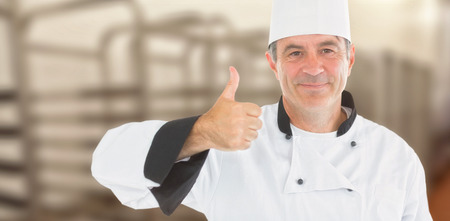 composite image: Composite image of friendly chef smiling with thumbs up against a blurred background