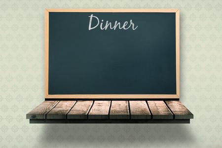 wooden shelf: Dinner message against black board on a wooden shelf Stock Photo