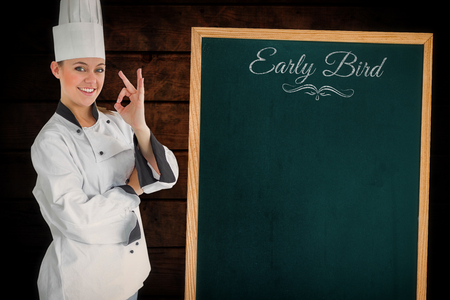 satisfying: Composite image of satisfying woman chef next to a blackboard