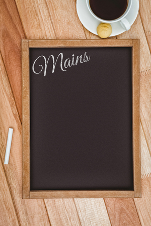 mains: Mains message  against composite image of a slate and coffee mug