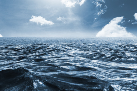 choppy: Blue rough ocean against blue sky Stock Photo