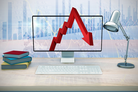 regression: A computer over a deskagainst stocks and shares Stock Photo