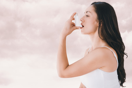asthmatic: Image of an asthmatic woman against light grey Stock Photo