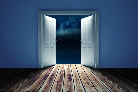door opening: Door opening in dark room to show sky against stars twinkling in night sky