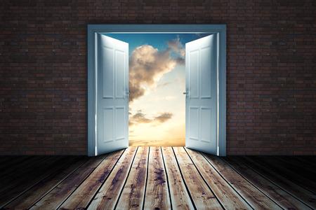 door opening: Door opening in dark room to show sky against blue and orange sky with clouds