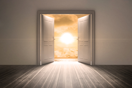 escapism: Open big door on wall against a beautiful sunset