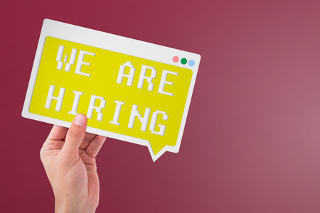 cropped: We are hiring messageagainst red background