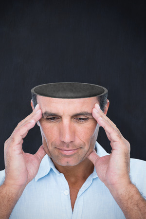 hand on forehead: Handsome man thinking with hand on forehead against blackboard Stock Photo
