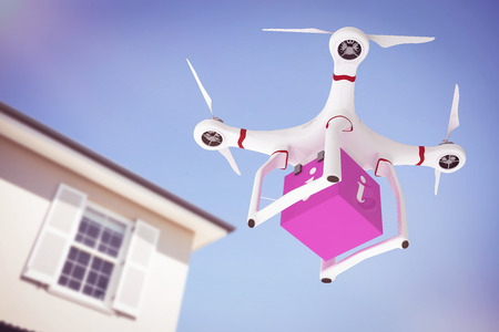 domiciles: A drone bringing a pink cube against house Stock Photo