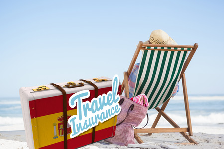 spanish looking: Travel insurance message on a Spanish suitcase against woman looking the sea