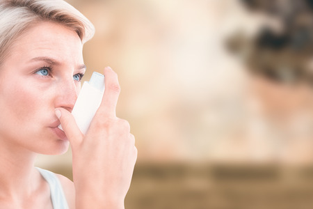 affliction: Blonde woman taking her inhaler against field against glowing lights