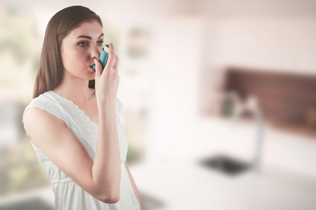 greenness: Portrait of an asthmatic woman  against empty modern kitchen Stock Photo