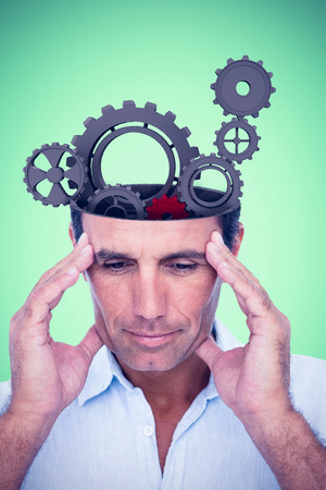 hand on forehead: Handsome man thinking with hand on forehead against green background Stock Photo