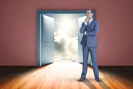 door opening: Thinking businessman against door opening in dark room to show sky
