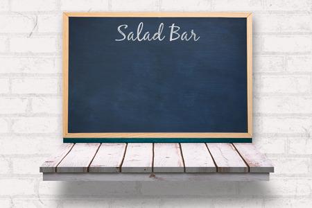 wooden shelf: Salad bar message against blackboard on a wooden shelf