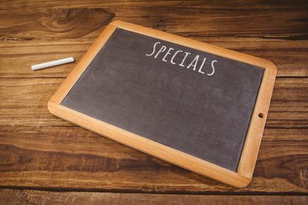 hight tech: Specials message against chalkboard on desk