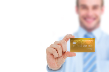 creditcard: Happy businessman showing a creditcard