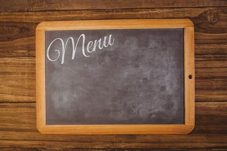 hight tech: Menu message  against chalkboard on desk Stock Photo