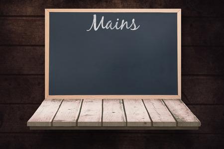 wooden shelf: Mains message  against blackboard on a wooden shelf