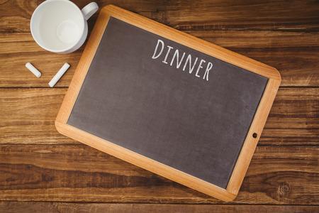 hight tech: Dinner message against chalkboard on desk Stock Photo