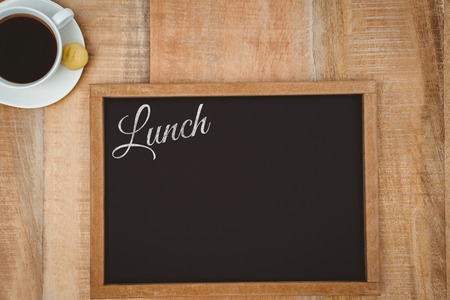 composite image: Lunch message on a white background against composite image of a slate and coffee mug