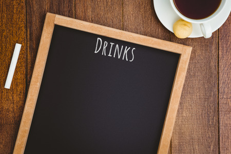 hight tech: Drinks message against composite image of a slate with a coffee mug