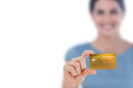 creditcard: Happy businesswoman showing a creditcard