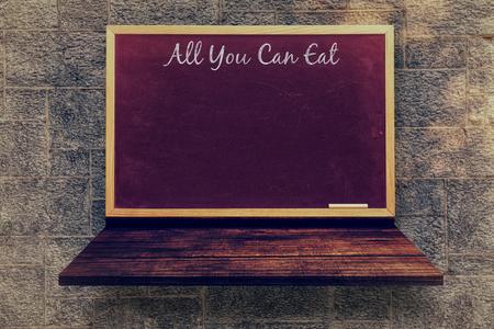 wooden shelf: All you can eat message  against blackboard on a wooden shelf