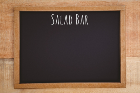 composite image: Salad bar message against composite image of a slate