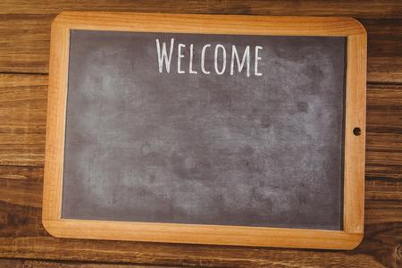 welcome desk: Welcome message  against chalkboard on desk