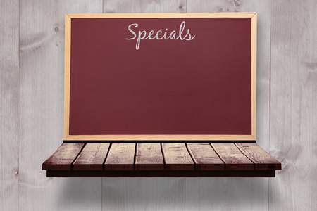 specials: Specials message  against board on a wooden shelf