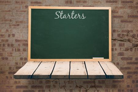 wooden shelf: Starters message  against blackboard on a wooden shelf
