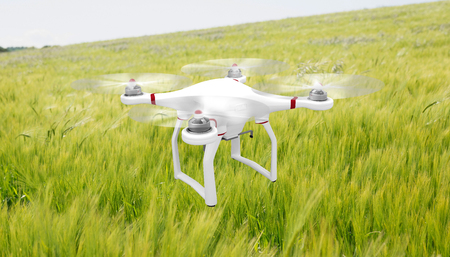Image of a drone against green meadow