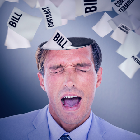 Stressed businessman getting a headache against digitally generated grey vignette background Stock Photo