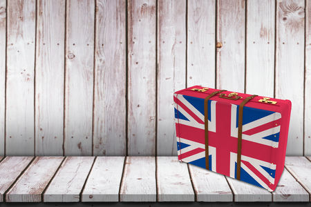great britain flag: Great Britain flag suitcase against wooden table Stock Photo