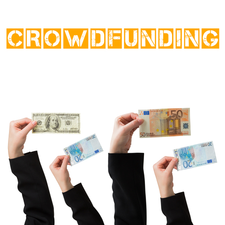 female likeness: Businesswomans hand holding fifty euro notes against the word crowdfunding Stock Photo
