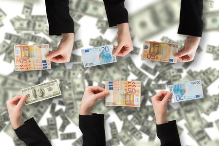 hundred dollar bill: Businesswomans hand holding hundred dollar bill against digital image of money
