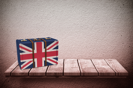 great britain flag: Great Britain flag suitcase against wooden shelf