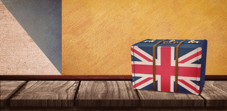 great britain flag: Great Britain flag suitcase against wooden table on a texture and coloured wall Stock Photo