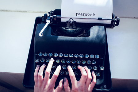 one room school house: The word password: against womans hand typing on typewriter Stock Photo