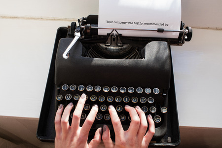 one room school house: The word your company was highly recommended by against womans hand typing on typewriter