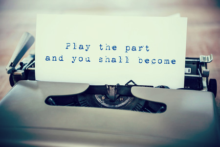 become: Play the part and you shall become message against a paper in a printer
