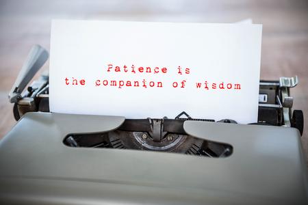paciencia: La paciencia es el compañero de la sabiduría en contra de un papel en una impresora Foto de archivo