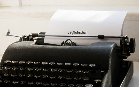 one room school house: The word legislation against typewriter on a table Stock Photo