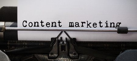 Content marketing message against close-up of typewriter