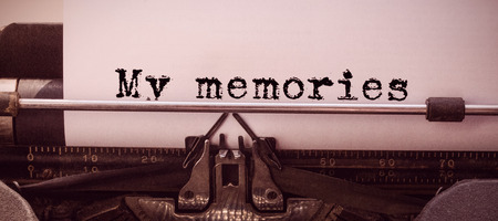 the word my memories against white background against close-up of typewriter
