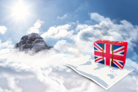 great britain flag: Great Britain flag suitcase against mountain peak through the clouds