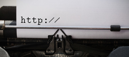 pencil and paper: http written against white background against close-up of typewriter