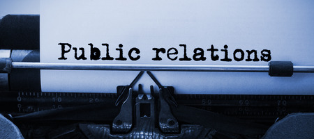 public relations: Words public relations against white background against close-up of typewriter