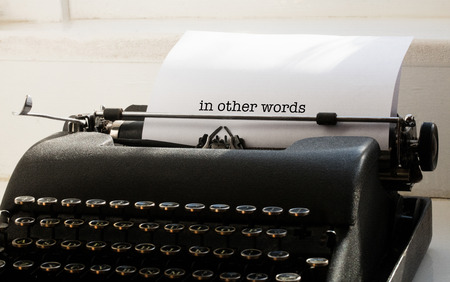 one room school house: The word in other words against typewriter on a table